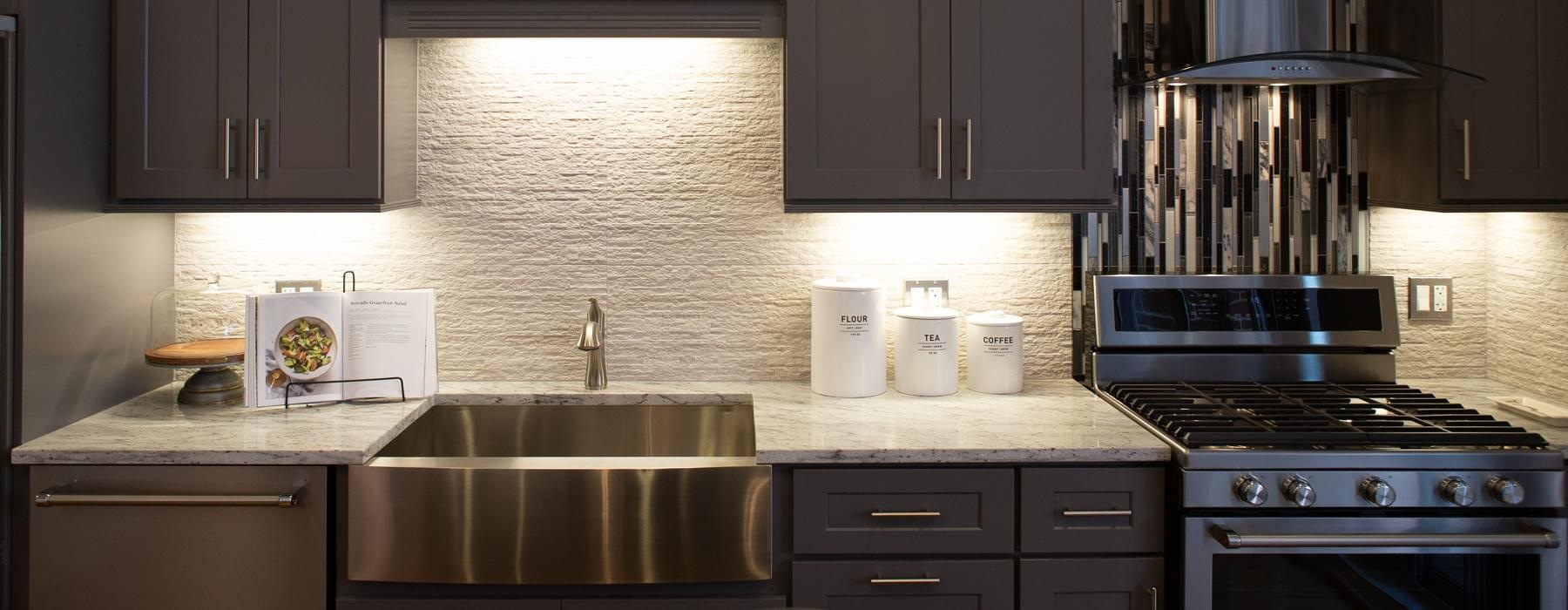 kitchen with lighting under cabinets brightening countertops