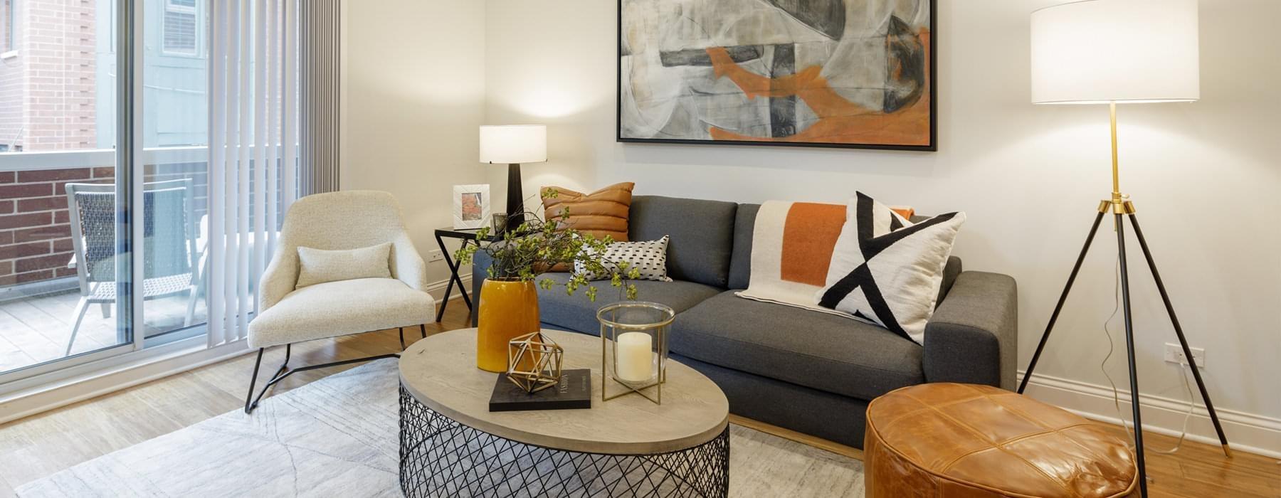 living room accesses private balcony through sliding glass door